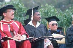 Cultureel diverse faculteit in formele robes stock fotografie