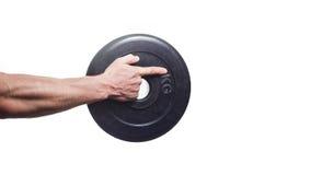 Culturista dell'atleta, tenente a disposizione un disco per le teste di legno immagine stock libera da diritti