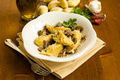 Culurgiones with mushrooms. Dish of typical sardinian pasta stuffed with mushrooms, Sardinian Cuisine stock image