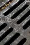 Culvert. Extreme close up and detail of iron culvert on the street Stock Photos