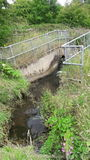 Culvert draining into River Rother Royalty Free Stock Photos