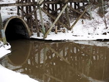 Culvert With Muddy Creek And Trestle In Winter Stock Image