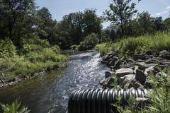 Culvert runoff to stream Stock Images