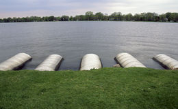 Culverts. Five culverts jut out into the lake Stock Photo