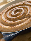 Cumberland Sausage Coil in a Frying Pan Stock Images