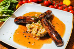 Cumberland sausage and mash with gravy Stock Images
