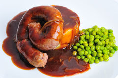 Cumberland sausage with peas. And gravy royalty free stock photography
