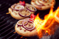 Cumberland sausage, spiral pork sausage on bbq grill with flame, Royalty Free Stock Photo