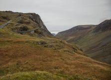 Cumbria, Engeland, het UK, Europa - weiden, heuvels en bewolkte hemel stock fotografie