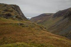 Cumbria, Engeland - weiden, heuvels en bewolkte hemel stock fotografie