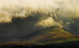 Cumbria storm. A storm moving in over the hills in cumbria, england, uk Royalty Free Stock Photo