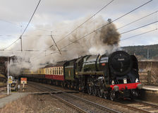 The Cumbrian Guardsman. Preserved steam locomotive 70000 Britannia, heads the Cumbrian Guardsman southbound through Penrith station in Cumbria on March 02, 2013 Royalty Free Stock Images