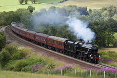 The Cumbrian Mountain Express. Preserved steam locomotive 45305 heads the Cumbrian Mountain Express through Armathwaite on July 23, 2011, on the Settle to Stock Images