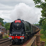 Cumbrian Mountain Express. Preserved steam locomotive 46233, Duchess of Sutherland, heads the Cumbrian Mountain Express into Lazonby station on July 28, 2012, on Stock Images