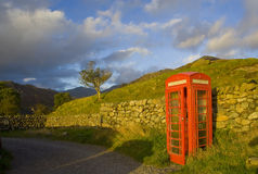 Cumbrian rural red phone box. Red british telephone box by the road  to hardknott pass in Eskdale northern Cumbrian Mountains, Lake District, Cumbria, England Stock Photos