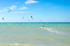Multiple sports man flying on their kite boarding stock photography