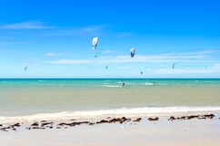 Several kite surfing on the air at the Cumbuco. Cumbuco, Brazil, jul 9, 2017: Several kite surfing on the air at the Cumbuco beach in Ceara Stock Images
