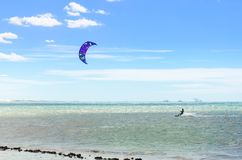Several kite surfing on the air at the Cumbuco. Cumbuco, Brazil, jul 9, 2017: Several kite surfing on the air at the Cumbuco beach in Ceara Royalty Free Stock Photo