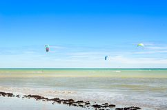 Several kite surfing on the air at the Cumbuco. Cumbuco, Brazil, jul 9, 2017: Several kite surfing on the air at the Cumbuco beach in Ceara Royalty Free Stock Photos