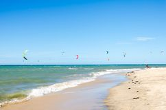 Several kite surfing on the air at the Cumbuco. Cumbuco, Brazil, jul 9, 2017: Several kite surfing on the air at the Cumbuco beach in Ceara Royalty Free Stock Images