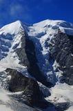 Cumes suíços: A geleira de Piz Buin em montanhas do grupo de Bernina perto de Pontresina fotos de stock royalty free