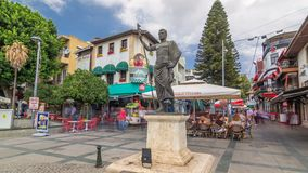 The Cumhuriyet square with numerous cafes and bars, statue of Attalos II and souvenir stores timelapse hyperlapse in stock video