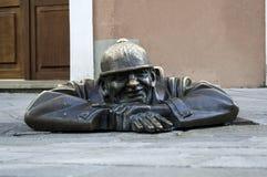 Cumil, Bratislava statue. Royalty Free Stock Image