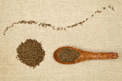 Cumin. Seeds decorative arranged on brown background Stock Photo