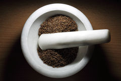 Cumin. Seeds in white marble shredder from top Stock Photos