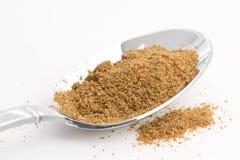 Cumin. Spoon full of cumin seasoning stock images