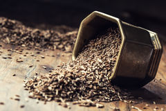Cumin.Caraway seeds on wooden table. Cumin in vintage bronze bowl and spoon.  stock images