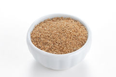 Cumin ground in a white bowl on white background. royalty free stock image