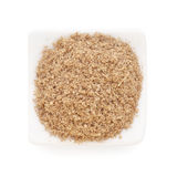 Cumin ground in a white bowl on white background. Stock Photos