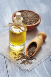Cumin oil in a glass bottle Stock Photo