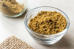 Cumin Powder in Glass Bow with Sack Royalty Free Stock Photos