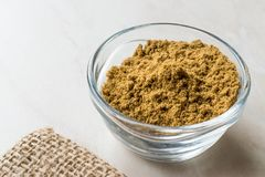 Cumin Powder in Glass Bowl with Sack. Cumin Powder in Glass Bow with Sack. Organic Food Stock Images