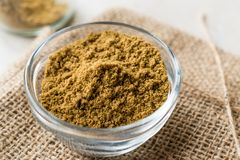 Cumin Powder in Glass Bowl with Sack Royalty Free Stock Photography