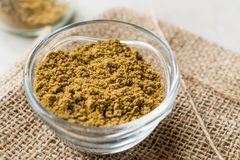 Cumin Powder in Glass Bow with Sack Royalty Free Stock Image