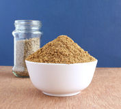 Cumin Powder. Healthy food cumin powder in a bowl and, in the background, a glass of cumin seeds Royalty Free Stock Photography