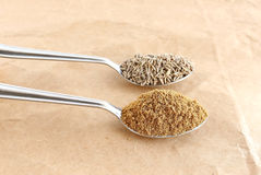 Cumin Powder. Healthy food cumin powder and cumin seeds in steel spoons Royalty Free Stock Images