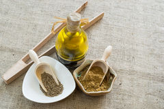 Cumin. Powder and seeds in two separate bowls stock image