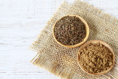 Cumin powder and seeds Royalty Free Stock Images