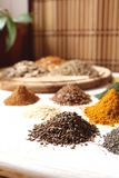 Cumin seeds. Cumin and other colorful spices, aromatic and healthy ingredients stock images
