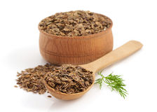 Cumin seeds in bowl on white background Stock Image