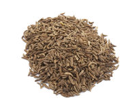 Cumin seeds , indian spice. Isolated on a white background Stock Photos