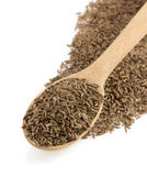 Cumin seeds in spoon Royalty Free Stock Images