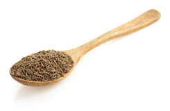 Cumin seeds in spoon on white Royalty Free Stock Photos