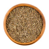 Cumin seeds in a wooden bowl over white Royalty Free Stock Photography