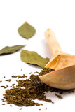 Cumin on wooden spoon and bay leaves Royalty Free Stock Photo