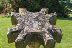 Sundial at Dumfries House in Cumnock, Scotland, UK. Cumnock, Ayrshire, Scotland, UK - June 18, 2012: Molded stone octogenal sundial in garden of Dumfries House royalty free stock images